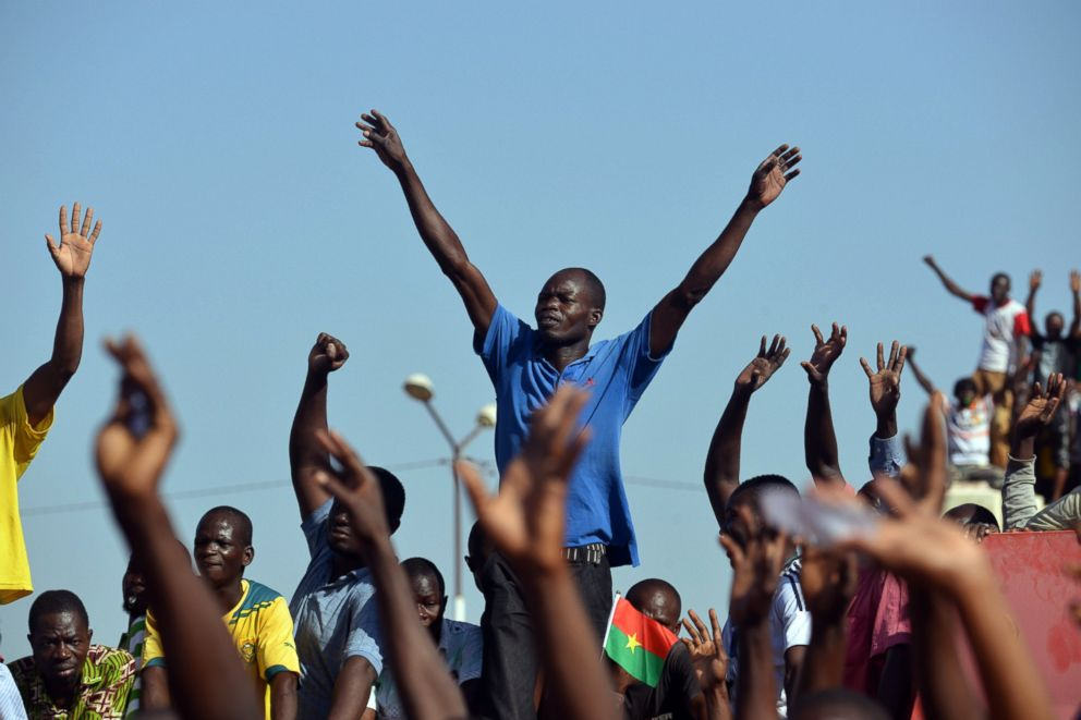 Opposition supporters takes part in a protest against a proposal to amend the constitution to extend President Blaise Compaore's 27-year-rule, Oct. 28,2014 in Ouagadougou, Burkina Faso.