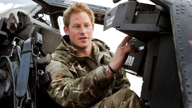 PHOTO: Prince Harry or just plain Captain Wales as he is known in the British Army, makes his early morning pre-flight checks on the flight-line, from Camp Bastion southern Afghanistan, Dec. 12, 2012.