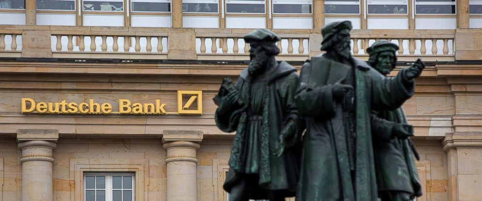 PHOTO: Statues stand outside a Deutsche Bank AG bank branch in Frankfurt, Germany, on Thursday, Oct. 20, 2016.