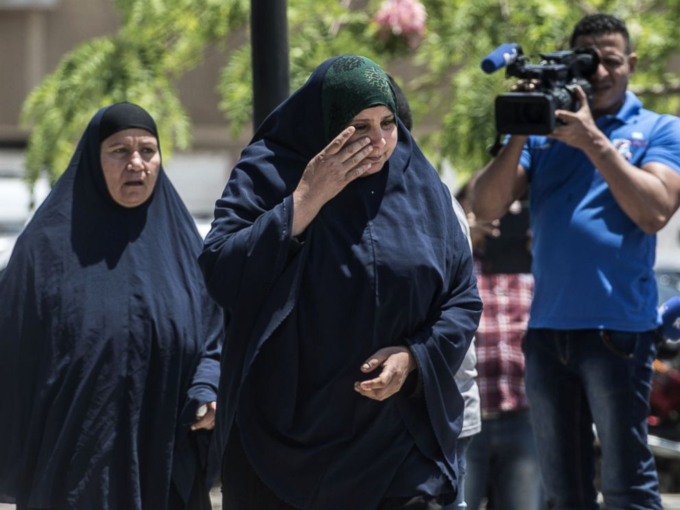 PHOTO: A relative of a passenger who was flying aboard an EgyptAir plane that vanished cries as family members are transported by bus to a gathering point at Cairo airport on May 19, 2016.
