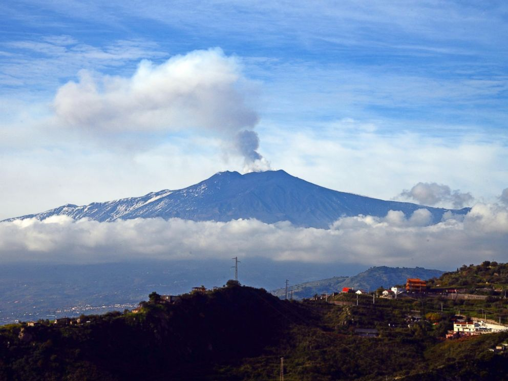 PHOTO: Smoke rises over the city of Taormina during an eruption of the Mount Etna, one of the most active volcanoes in the world, near Catania, on Dec. 4, 2015.