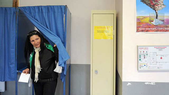 PHOTO: Algerian Chafia Mentalecheta, leader of the Union Democratic and Social Forces leaves the voting booth at a polling station.