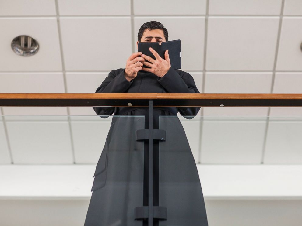 PHOTO: A priest who is a student of the Pontifical Athenaeum Regina Apostolorum reads the Bible during class break while the Exorcism and Prayer of Liberation annual conference is taking place on May 5, 2014 in Rome. Italy