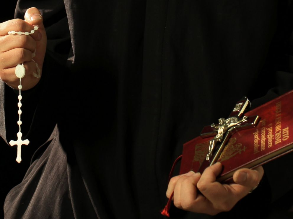 PHOTO: Don Aldo Buonaiuto holds the necessary objects for his exorcisms on Jan. 12, 2012 in Rome, Italy.