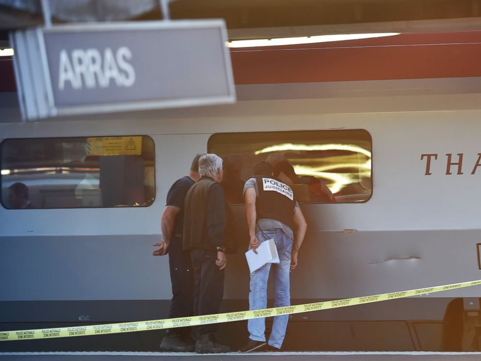 PHOTO: Crime investigators look into the window of a Thalys train at the main train station in Arras, northern France, on Aug. 21, 2015.