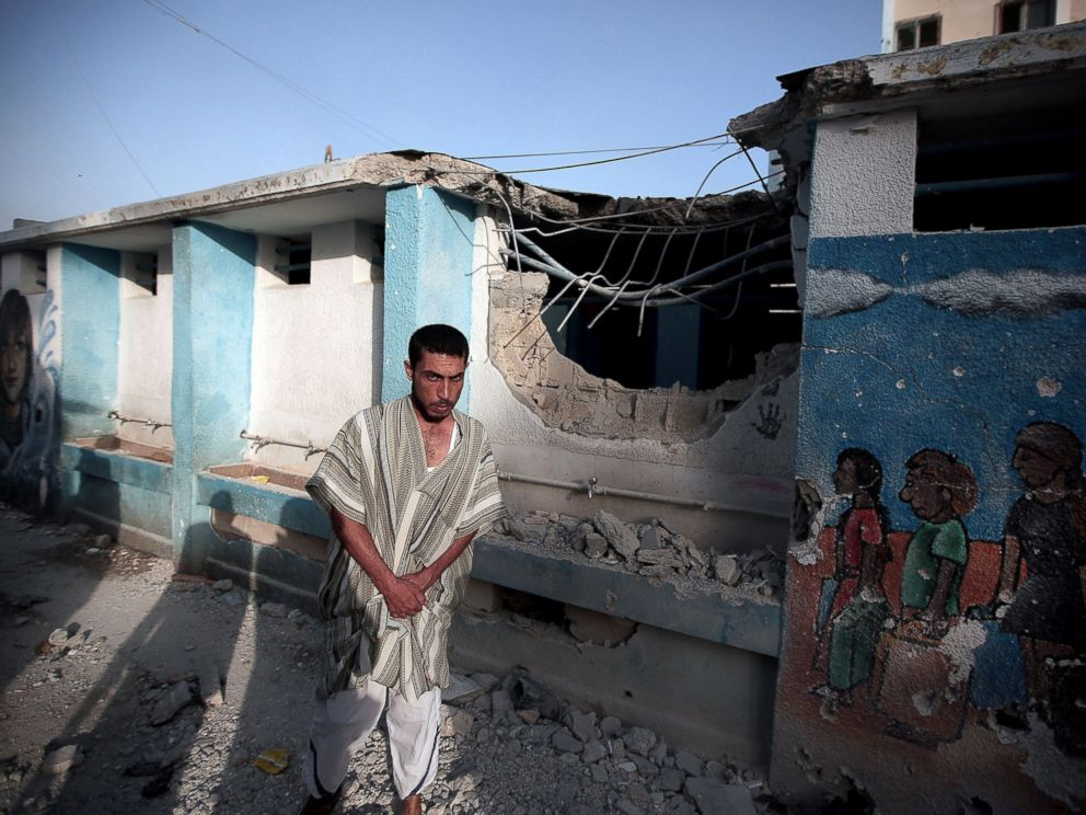 PHOTO: A Palestinian man is seen in Abu Hussein School which was sheltering displaced Palestinians when it was hit by a Israeli tank shell attack, killing at least 17 people according to the Associated Press on July 30, 2014.