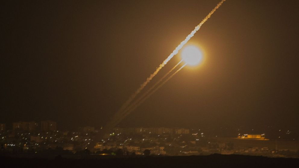 A picture taken from the southern Israeli Gaza border shows rockets being fired from the Gaza strip into Israel, on July 12, 2014.