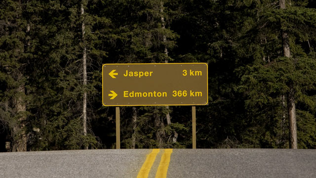 PHOTO: A sign for Highway 16 points to Edmonton and Jasper in the Alberta province of Canada.