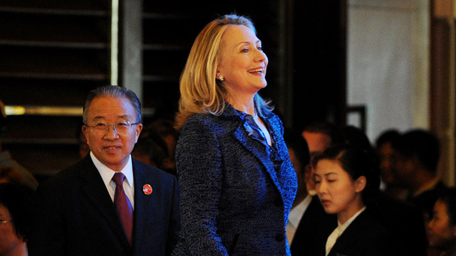 PHOTO: US Secretary of State Hillary Clinton (C) and China's State Councillor Dai Bingguo (L) arrive for the opening ceremony of the US-China Strategic and Economic Dialogue at the Diaoyutai Guesthouse in Beijing on May 3, 2012.