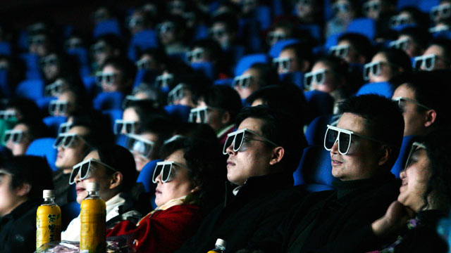 PHOTO: Audience members watch a movie through 3D glasses at a newly opened IMAX theatre on February 8, 2007 in Wuhan of Hubei Province, China in this file photo.