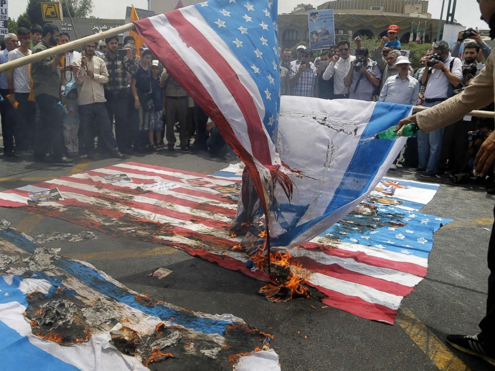 PHOTO: Iranian protestors set US and Israeli flags afire during a parade marking al-Quds (Jerusalem) Day in Tehran, July 01, 2016. Tens of thousands joined pro-Palestinian rallies in Tehran.