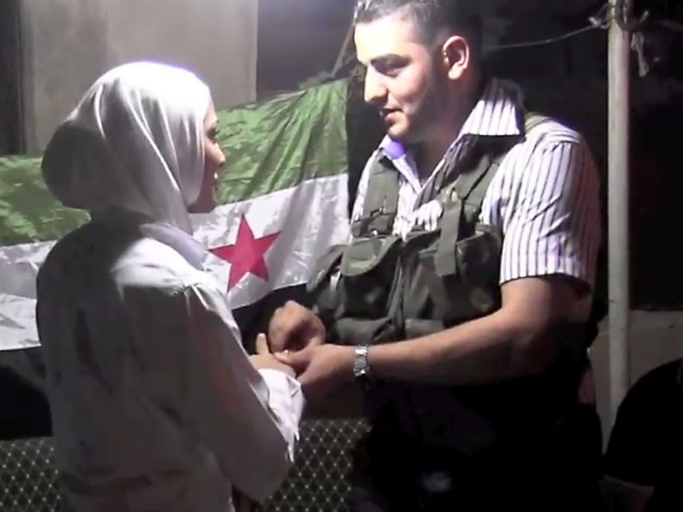 PHOTO:An image grab taken from AFP TV shows Syrian rebel sniper Abu Khaled exchanging rings with his bride Hanan during their wedding ceremony in Aleppo, Aug. 31, 2012.