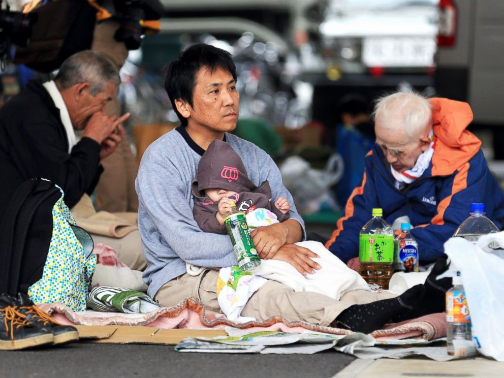 PHOTO: Evacuees spend time at an evacuation center on April 16, 2016 in Mashiki, Kumamoto, Japan.