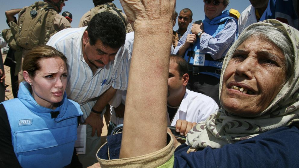 Angelina Jolie meeting an elderly refugee, one some 1,300 trapped at the makeshift Al Waleed camp inside Iraq, unable to leave the country for neighboring Syria, Aug. 28, 2007.