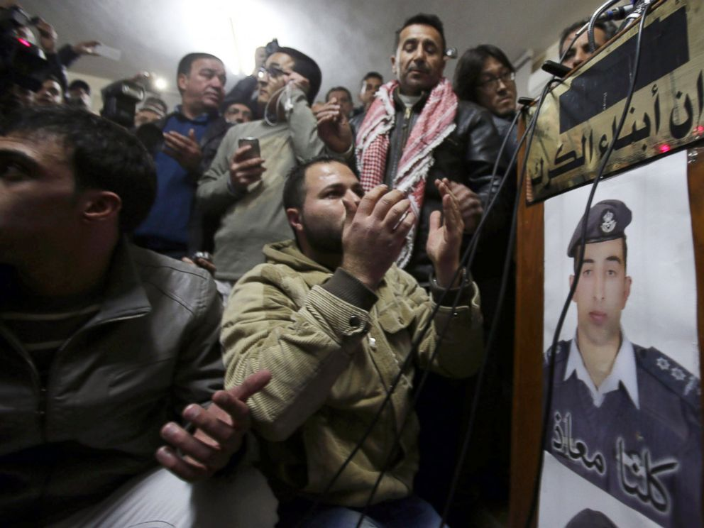 PHOTO: A man prays for Jordanian pilot Muath al-Kasasbeh after hearing the news of his execution at the Kasasbeh tribe society on Feb. 3, 2015 in Amman, Jordan.