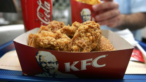 PHOTO: An employee serves a portion of Kentucky Fried Chicken and chips at the international chains local franchise February 17, 2006 in Tel Aviv, Israel.
