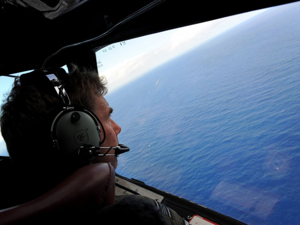 PHOTO: Co-pilot and Squadron Leader Brett McKenzie of the Royal New Zealand Airforce P-3K2-Orion aircraft, helps to look for objects during the search for missing flight MH370 in flight over the Indian Ocean off the coast of Perth, Australia.