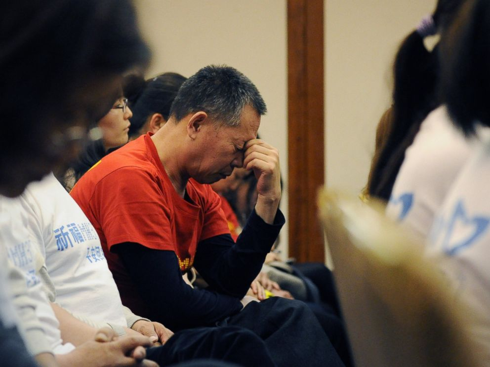 PHOTO: A man reacts as Chinese relatives of passengers on the missing Malaysia Airlines flight MH370 attend a meeting at the Metro Park Hotel in Beijing on April 21, 2014.