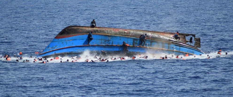 PHOTO: A handout picture from the Italian Navy shows the shipwreck of an overcrowded boat of migrants off the Libyan coast, May 25, 2016.