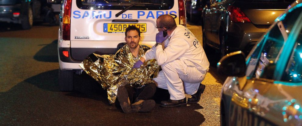 PHOTO: A medic tends to a man near the Boulevard des Filles-du-Calvaire after an attack, Nov. 13, 2015 in Paris.