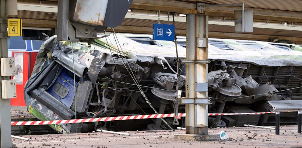 "PHOTO: A picture shows a derailed wagon on the site of a train accident in the railway station of Bretigny-sur-Orge on July 12, 2013 near Paris. A train derailed in the Paris suburb of Bretigny-sur-Orge in an accident that caused ""many casualties"", author"