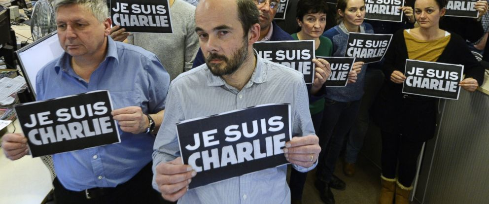 "PHOTO: Journalists hold placard reading ""I am Charlie"" as they hold a minute of silence at the French news agency Agence France Presse, following the attack by gunmen in the offices of the French satirical weekly Charlie Hebdo, Paris, Jan. 7, 2015."