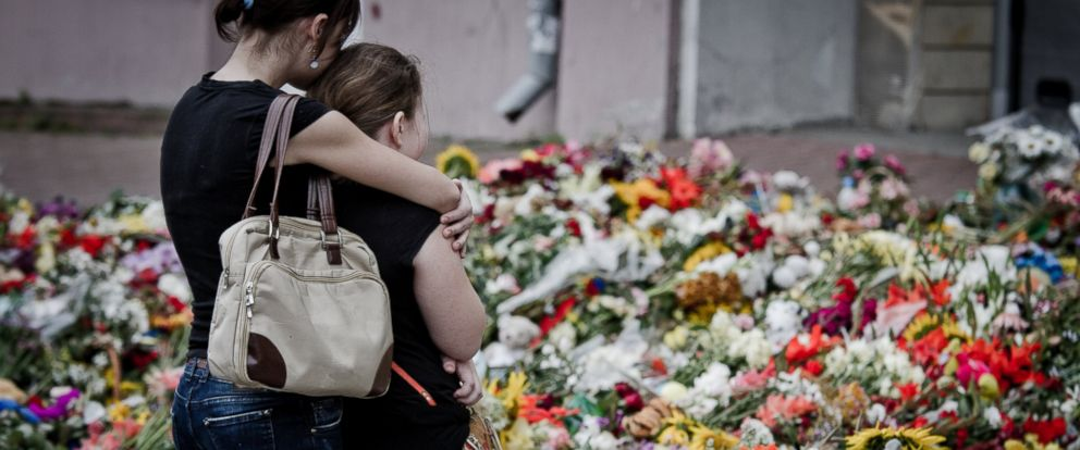 PHOTO: Relatives of the MH 17 air crash cry in front of Embassy of the Kingdom of The Netherlands in Kiev, Ukraine.