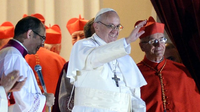 PHOTO: Argentinas cardinal Jorge Bergoglio, elected Pope Francis I appears with cardinals at the window of St Peters Basilica after being elected the 266th pope of the Roman Catholic Church on March 13, 2013 at the Vatican.