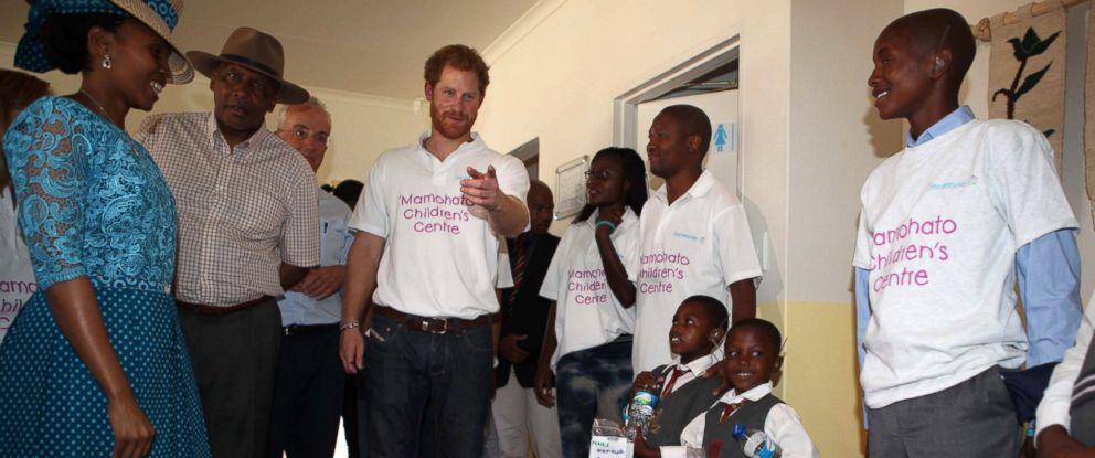 PHOTO: Children greet Prince Harry as he visits the Sentebale charity on Nov. 26, 2015 in Maeru, Lesotho, Sentebale.