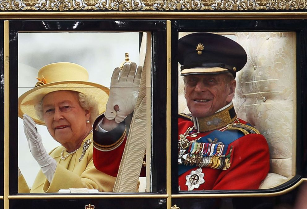 PHOTO: Queen Elizabeth II and Prince Philip ride in a carriage procession to Buckingham Palace following the marriage of Prince William and Catherine Duchess of Cambridge at Westminster Abbey on April 29, 2011 in London, England.