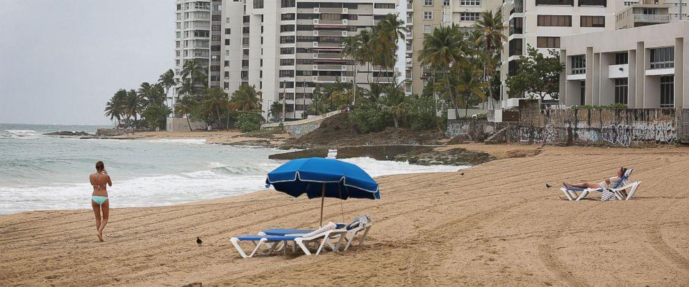 PHOTO: A woman walks on the beach on July 1, 2015 in San Juan, Puerto Rico.