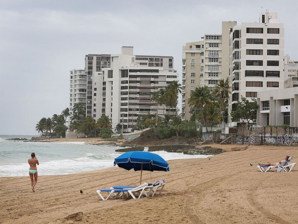 PHOTO: A woman walks on the beach on July 1, 2015 in San Juan, Puerto Rico.