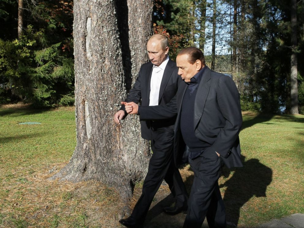 PHOTO: Russian Prime Minister Vladimir Putin (L) walks with his Italian counterpart Silvio Berlusconi in Saint Petersburg on October 9, 2010.