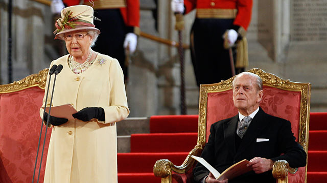 PHOTO: Queen Elizabeth II makes an address next to her husband The Duke of Edinburgh at Westminster Hall in London, March 20, 2012