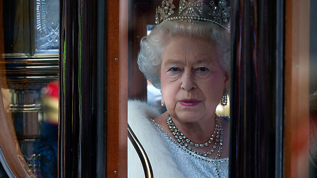 PHOTO: Queen Elizabeth II arrives in the Australian State Coach at the Palace of Westminster during the State Opening of Parliament in London, England.