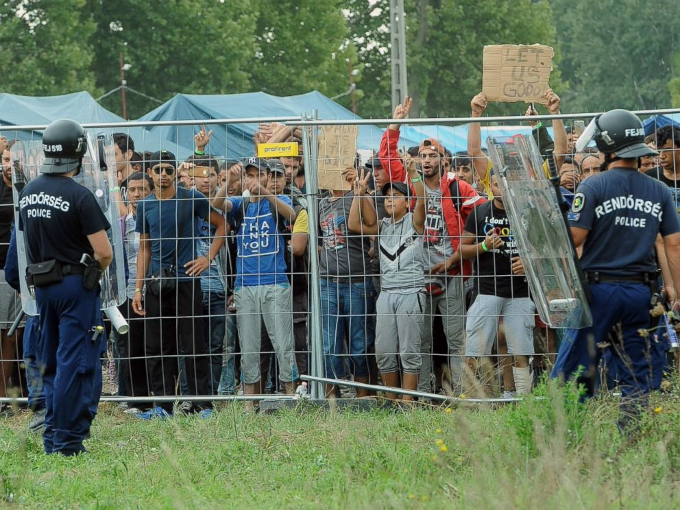 PHOTO: Police officers guard a refugee camp in the village of Roszke at the Serbian-Hungarian border on Sept. 4, 2015.