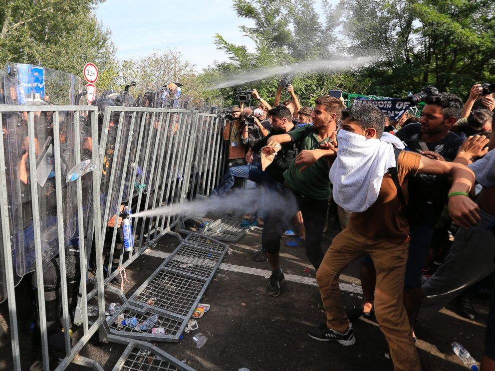 PHOTO: Hungarian police use pepper spray against refugees at the Horgos border after Hungarian authorities closed their border on Sept. 16, 2015 in Horgos, Serbia.