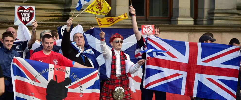 "PHOTO: Unionist supporters gather near George Square, where ""Yes"" activists had been holding a pre-referendum event Sept. 17, 2014, in Glasgow, Scotland."
