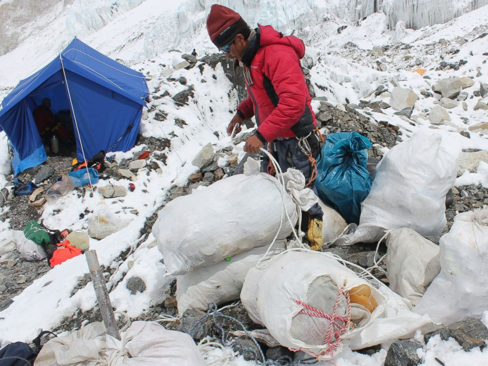 PHOTO: This picture taken on May 26, 2010 shows a Nepalese sherpa packing garbage collected from the Everest clean-up expedition at Everest Base Camp.