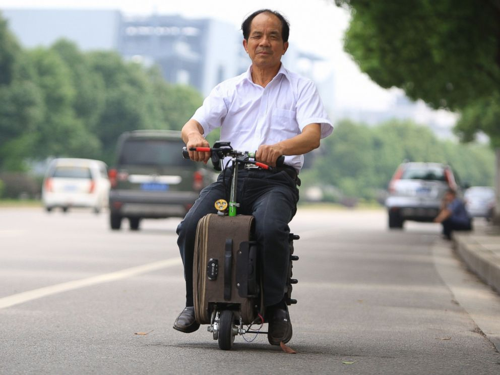 Photo Chinese Farmer He Liangcai Spent Ten Years Developing His Motorized Scooter Suitcase And Rides