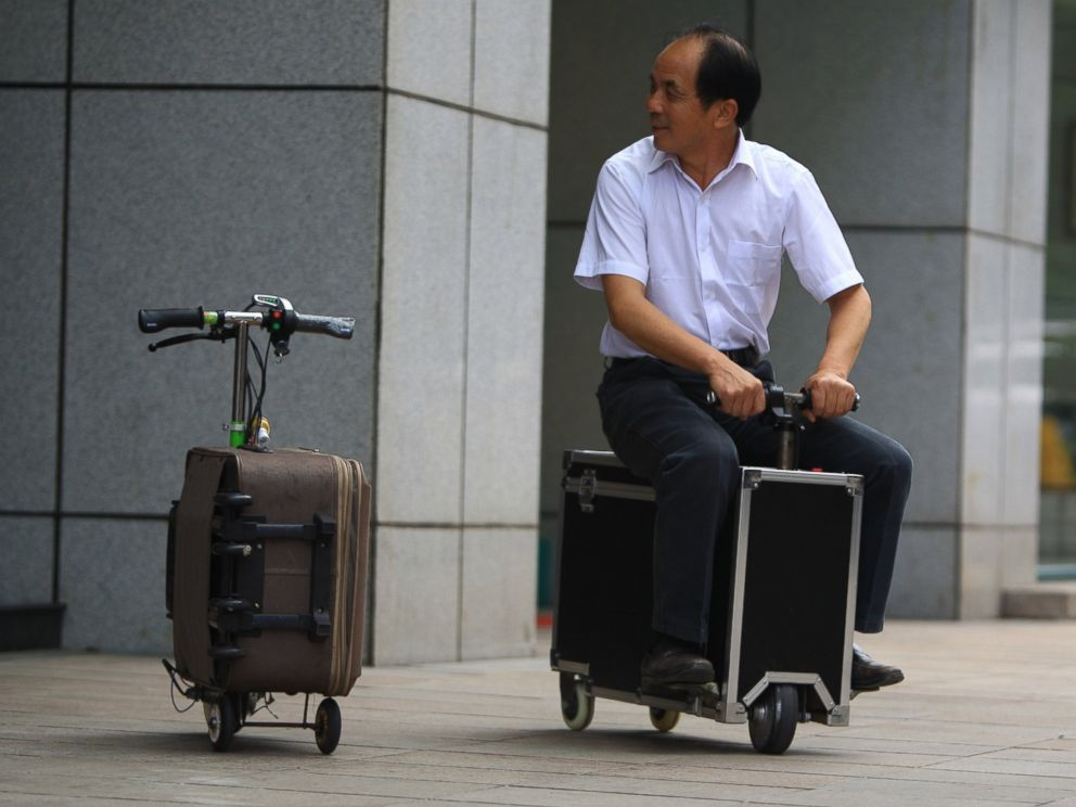 Chinese Inventor Gets Around On Suitcase Scooter