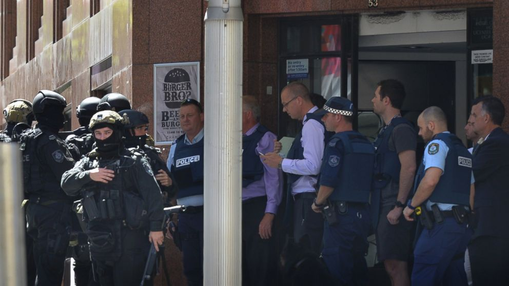 Armed police are seen outside a cafe in the central business district of Sydney on Dec. 15, 2014.