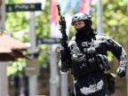 PHOTO: An armed policeman is seen outside a cafe in the central business district of Sydney on Dec. 15, 2014.