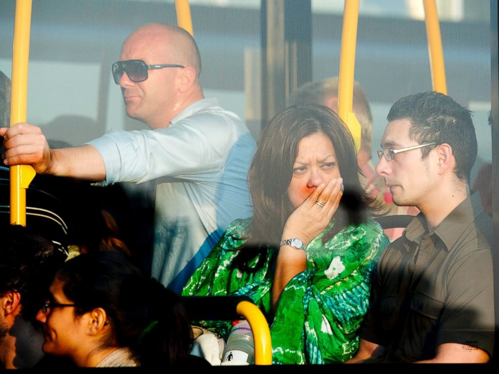 PHOTO: Family members of passengers killed in the crash of Air Malaysia flight MH17 leave Schiphol airport in a bus on July 17, 2014 in Amsterdam, Netherlands.
