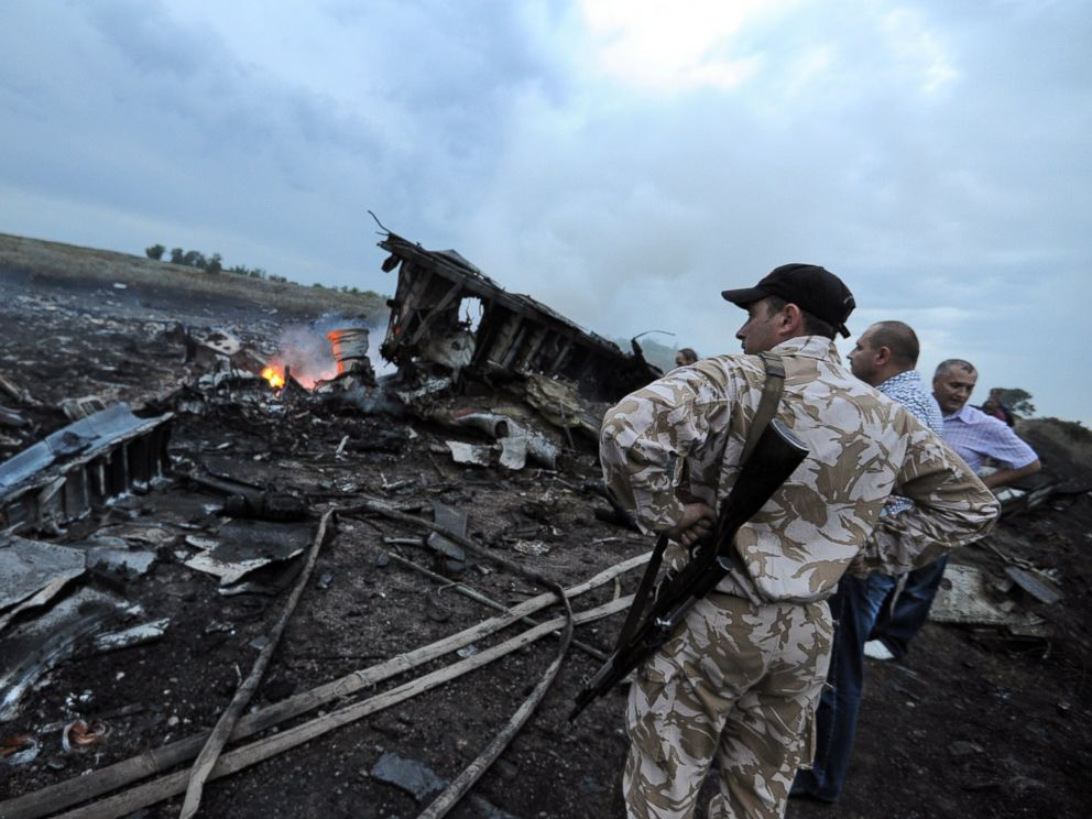 PHOTO: Men stand next to the wreckage of the Malaysian airliner that crashed near the town of Shaktarsk in rebel-held east Ukraine on July 17, 2014.