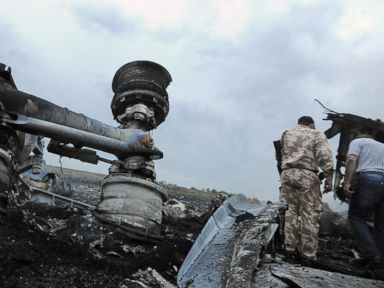 PHOTO: Men explore the wreckage of the Malaysian airliner that crashed in east Ukraine while traveling from Amsterdam to Kuala Lumpur on July 17, 2014.