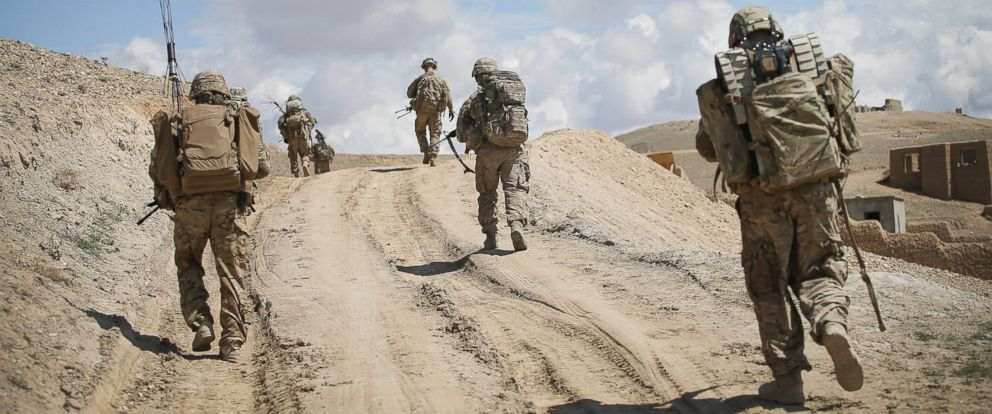 PHOTO: Soldiers with the U.S. Armys 2nd Battalion patrol on the edge of a village near Pul-e Alam, Afghanistan on March 29, 2014.