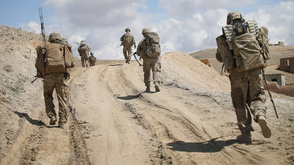 Soldiers with the U.S. Army's 2nd Battalion patrol on the edge of a village near Pul-e Alam, Afghanistan on March 29, 2014.