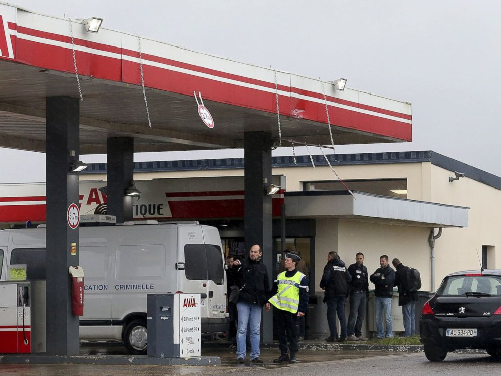 PHOTO: Gendarmes investigate where the two armed suspects from the attack on newspaper Charlie Hebdo were possibly spotted at an Avia gas station in Villers-Cotterets, north-east of Paris, Jan. 8, 2015.