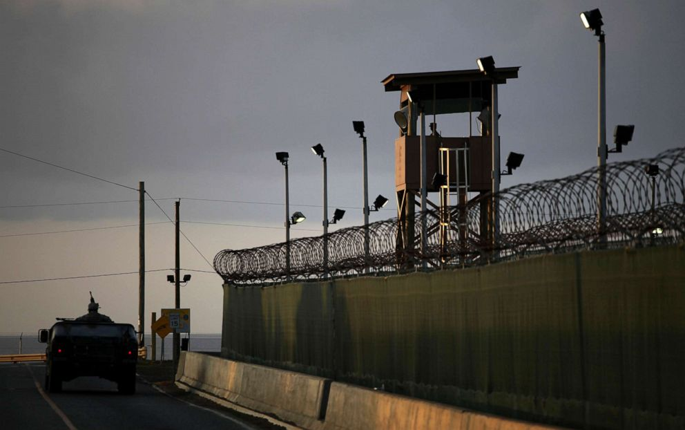 PHOTO: In this March 30, 2010 photo reviewed by the U.S. military, a U.S. trooper stands in the turret of a vehicle with a machine gun, left, as a guard looks out from a tower at the detention facility on Guantanamo Bay U.S. Naval Base in Cuba.